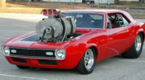 Camaro drag racer with a freight-train supercharger strapped to it. You won't believe your eyes.